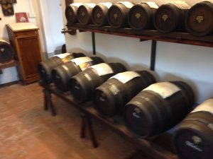 Barrels full of balsamic vinegar on a rack and aging until ready for consumption