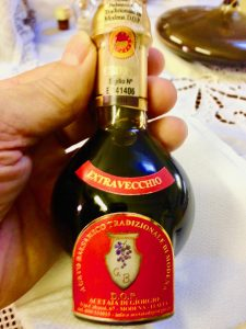 Bottle of balsamic vinegar aged for 15 years in barrels