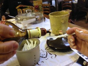 Balsamic vinegar being poured in to a spoon for a taste